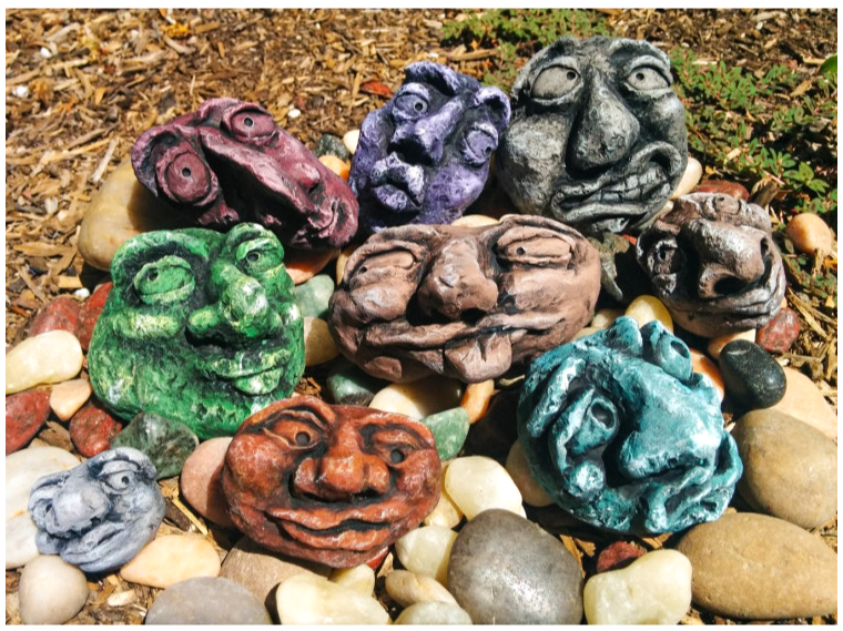 The rocks have eyes! And craggy lips, and wonky noses. These colorful rockin' sculptures are just rocklike enough to blend into the garden if you're not paying attention.